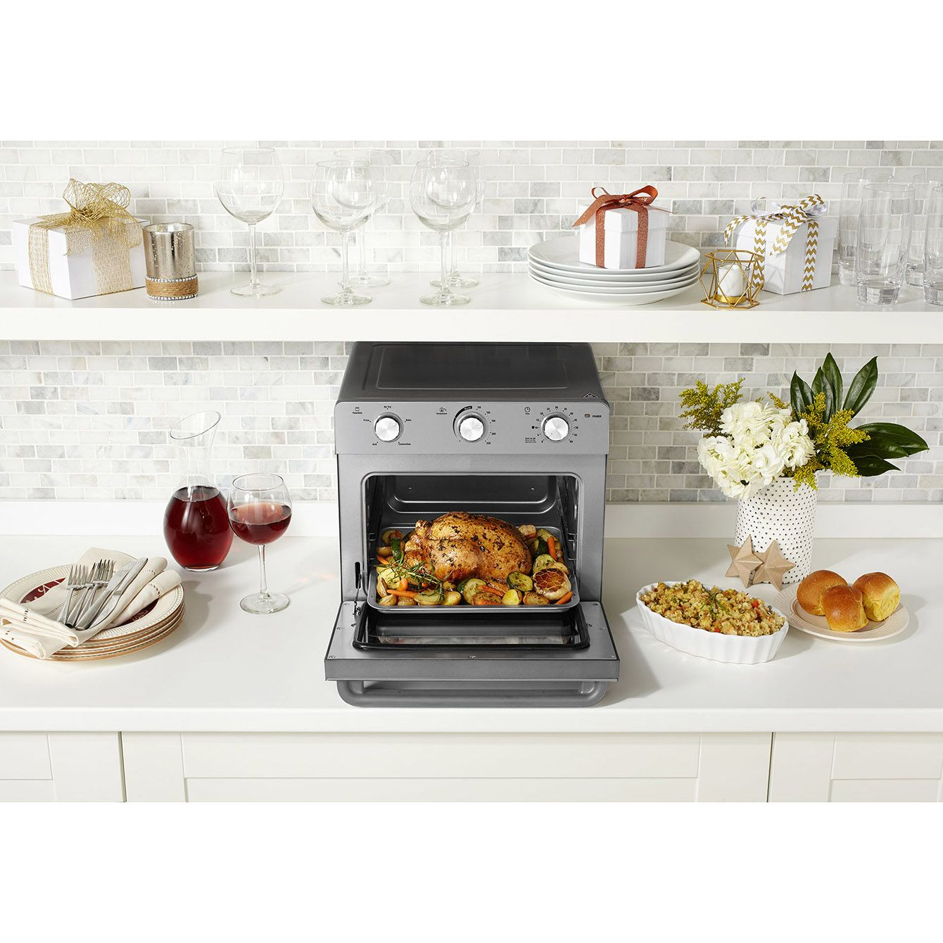 Sunbeam Multi Function Oven + Air Fryer makes healthier fries, chicken nuggets, pizzas and cakes